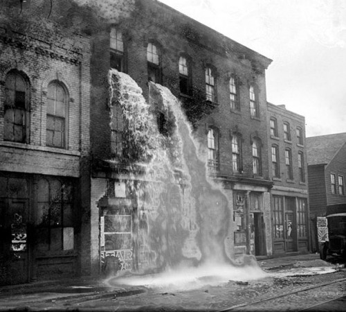 1929_Illegal_alcohol_being_poured_out_during_Prohibition_Detroit