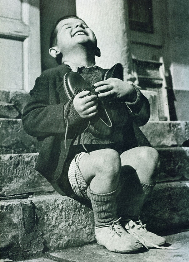 1943ca_Austrian_boy_receives_new_shoes_during