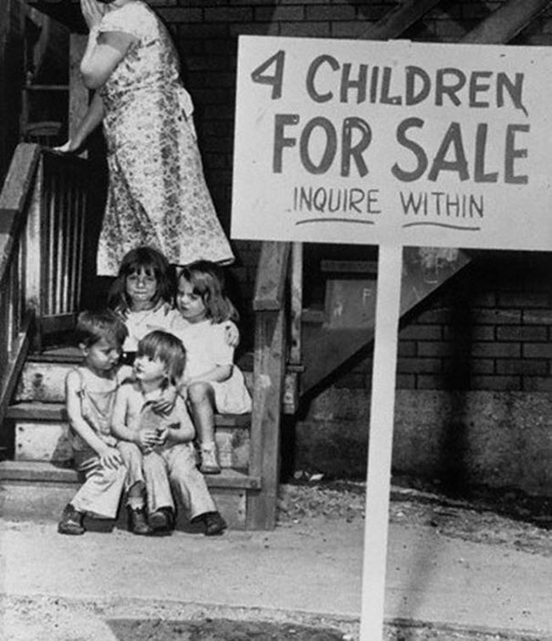 1948_Mother_hides_her_face_in_shame_after_putting_her_children_up_for_sale_Chicago